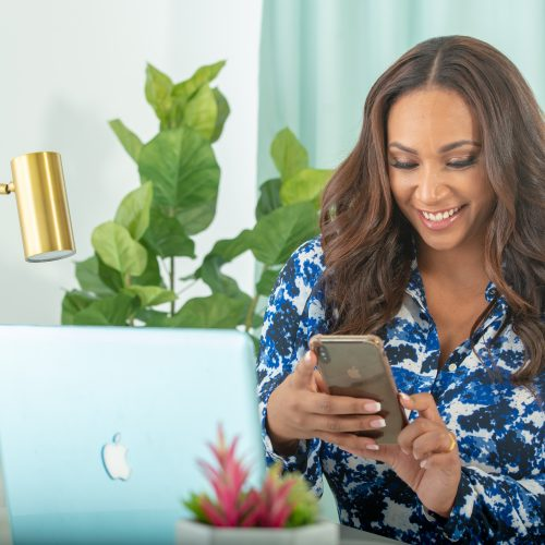 Tamika Bickham Creating Content on her Cell Phone and Laptop