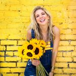 Woman with Sunflowers Founder of The Kind Effect